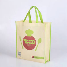 China Silk Screen Yellow Non Woven Fabric Bags With An Apple On The Surface supplier